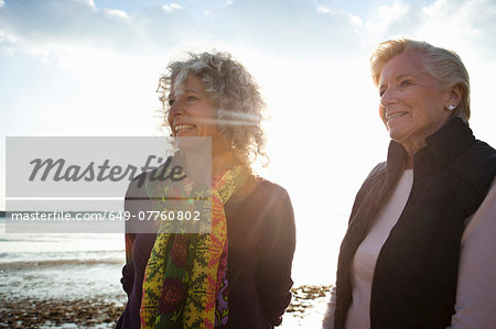 Mother and daughter enjoying view on beach Stock Photo - Premium Royalty-Free, Image code: 649-07760802