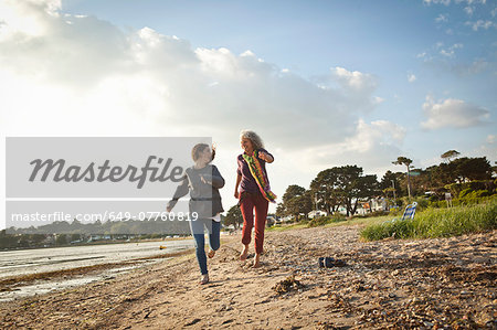 Mother and daughter enjoying beach Stock Photo - Premium Royalty-Free, Image code: 649-07760819