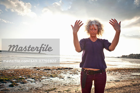 Mature woman exercising on beach Stock Photo - Premium Royalty-Free, Image code: 649-07760822