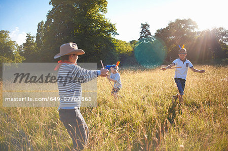 Group of young boys playing in a field Stock Photo - Premium Royalty-Free, Image code: 649-07760866