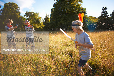 Group of young boys playing in field Stock Photo - Premium Royalty-Free, Image code: 649-07760867