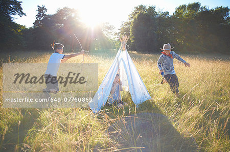 Small group of young boys playing around teepee Stock Photo - Premium Royalty-Free, Image code: 649-07760869
