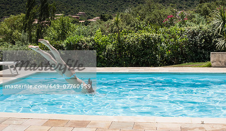 Young women diving into swimming pool, Capoterra, Sardinia, Italy Stock Photo - Premium Royalty-Free, Image code: 649-07760959