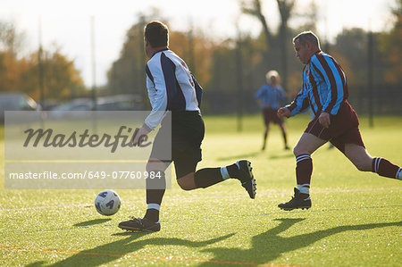 Football players during game Stock Photo - Premium Royalty-Free, Image code: 649-07760984