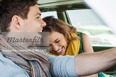 Young couple driving car laughing, Cape Town, Western Cape, South Africa Stock Photo - Premium Royalty-Free, Image code: 649-07803272