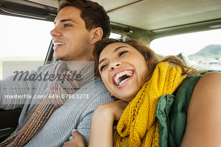 Young couple laughing whilst driving, Cape Town, Western Cape, South Africa Stock Photo - Premium Royalty-Free, Image code: 649-07803273