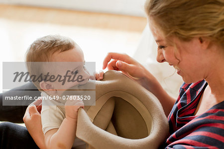 Mother playing with baby boy Stock Photo - Premium Royalty-Free, Image code: 649-07803520