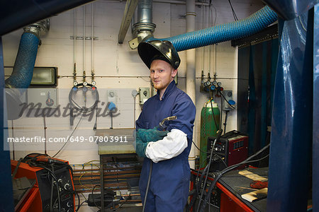 Portrait of male student welder in college workshop Stock Photo - Premium Royalty-Free, Image code: 649-07803911