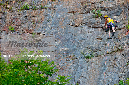 "Female climber, leading ""The Tory"" at Fairy Cave Quarry Stock Photo - Premium Royalty-Free, Image code: 649-07803941"
