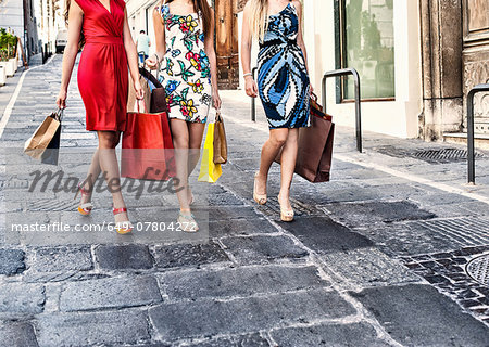 Neck down view of three fashionable young women shoppers, Cagliari, Sardinia, Italy Stock Photo - Premium Royalty-Free, Image code: 649-07804272