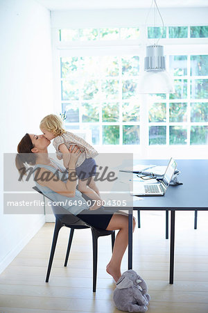 Mid adult woman holding up and kissing toddler daughter Stock Photo - Premium Royalty-Free, Image code: 649-07804305