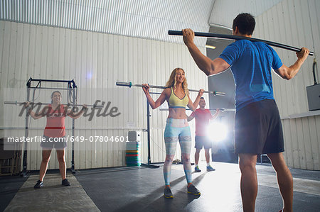 Crossfitters working out with bar in group class Stock Photo - Premium Royalty-Free, Image code: 649-07804601