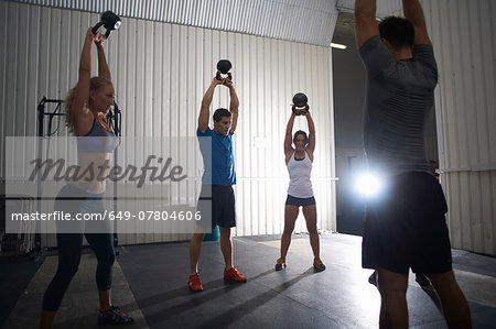 Crossfitters working out with kettlebell in group class Stock Photo - Premium Royalty-Free, Image code: 649-07804606