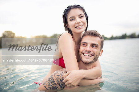 Attractive young couple hugging in lake Stock Photo - Premium Royalty-Free, Image code: 649-07804806