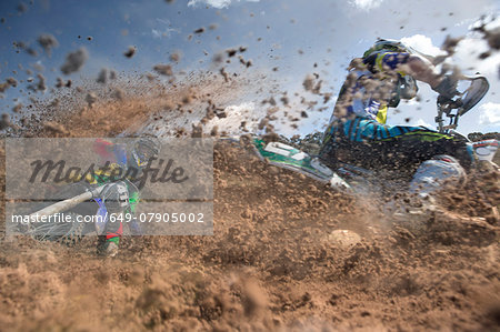 Two young male motocross riders racing through mud Stock Photo - Premium Royalty-Free, Image code: 649-07905002