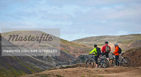 Three mountain bikers taking a break at viewpoint,  Reykjadalur valley, South West Iceland Stock Photo - Premium Royalty-Free, Image code: 649-07905693
