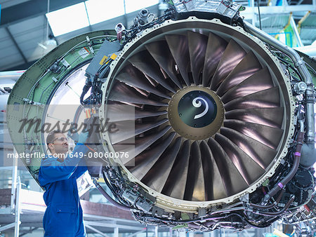 Engineers working on aircraft engine in aircraft maintenance factory Stock Photo - Premium Royalty-Free, Image code: 649-08060076