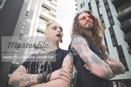 Low angle view of punk hippy couple with tattoos Stock Photo - Premium Royalty-Free, Image code: 649-08060324