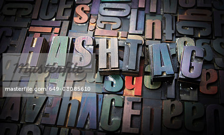 Letterpress letters spelling the word Hashtag Stock Photo - Premium Royalty-Free, Image code: 649-08085610