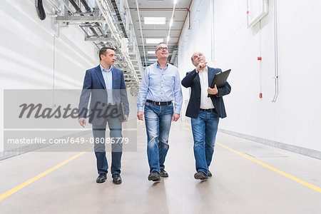 Three businessmen inspecting corridor in factory Stock Photo - Premium Royalty-Free, Image code: 649-08085779