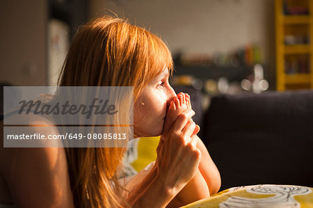 Mid adult woman kissing feet of toddler son in living room Stock Photo - Premium Royalty-Free, Image code: 649-08085813