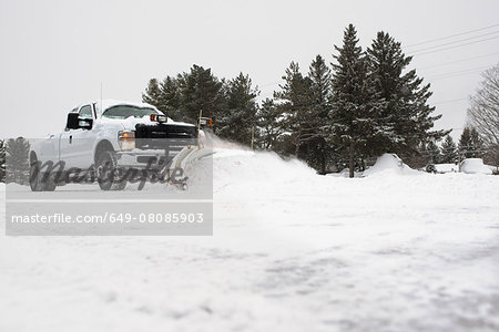 Truck clearing snow Stock Photo - Premium Royalty-Free, Image code: 649-08085903