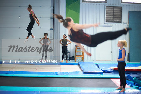 Young gymnasts practising moves Stock Photo - Premium Royalty-Free, Image code: 649-08085959