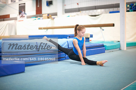 Young gymnast practising moves Stock Photo - Premium Royalty-Free, Image code: 649-08085960