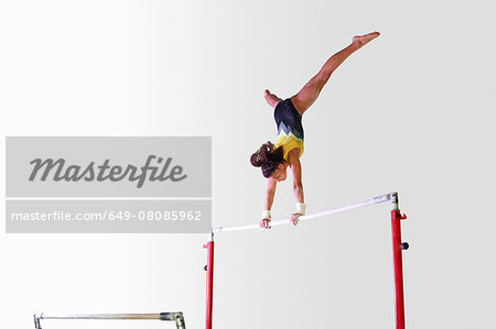 Young gymnast performing on uneven bars Stock Photo - Premium Royalty-Free, Image code: 649-08085962