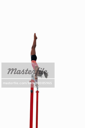 Young gymnast performing on uneven bars Stock Photo - Premium Royalty-Free, Image code: 649-08085965