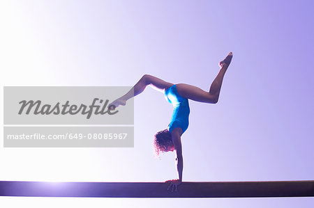 Young gymnast performing on balance beam Stock Photo - Premium Royalty-Free, Image code: 649-08085967