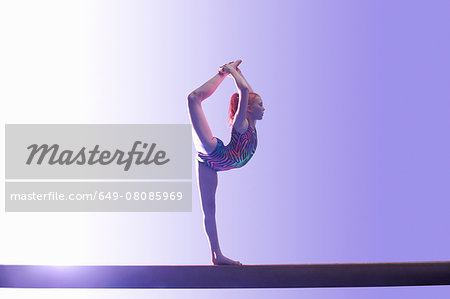 Young gymnast performing on balance beam Stock Photo - Premium Royalty-Free, Image code: 649-08085969