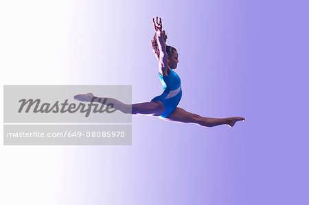 Young gymnast in mid-air leap Stock Photo - Premium Royalty-Free, Image code: 649-08085970