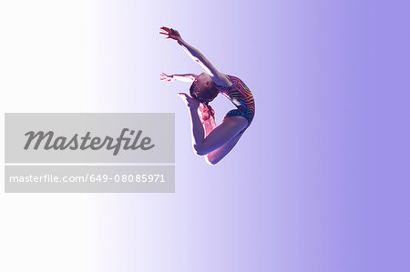 Young gymnast in mid-air leap Stock Photo - Premium Royalty-Free, Image code: 649-08085971
