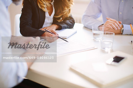 Cropped over the shoulder view of businesswoman signing contract Stock Photo - Premium Royalty-Free, Image code: 649-08086123