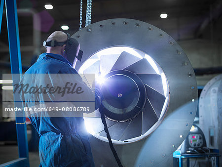 Engineer welding airduct part in engineering factory Stock Photo - Premium Royalty-Free, Image code: 649-08086789