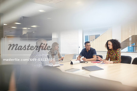 Business team meeting at conference table Stock Photo - Premium Royalty-Free, Image code: 649-08117803