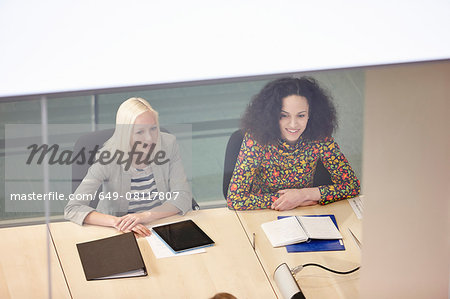 High angle view of businesswomen having meeting at conference table Stock Photo - Premium Royalty-Free, Image code: 649-08117807
