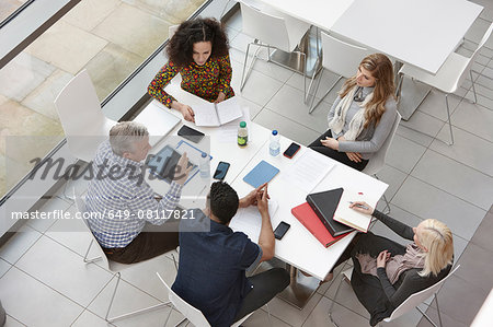 Overhead view of business team meeting at conference table