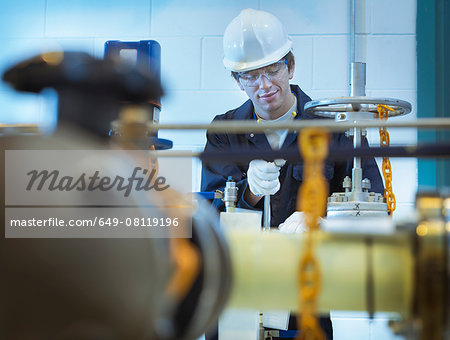 Apprentice engineer working in power station Stock Photo - Premium Royalty-Free, Image code: 649-08119196