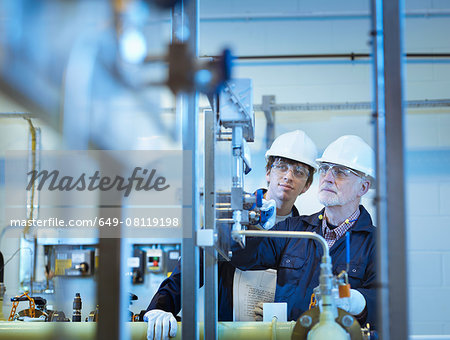 Senior and apprentice engineers working in power station Stock Photo - Premium Royalty-Free, Image code: 649-08119198