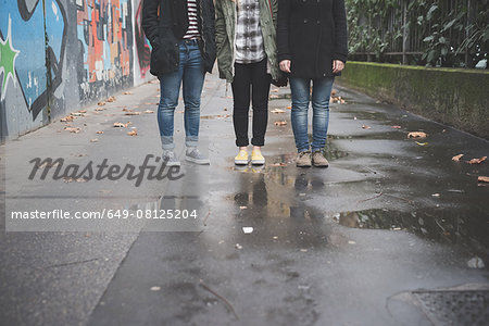 Three sisters by graffiti wall Stock Photo - Premium Royalty-Free, Image code: 649-08125204