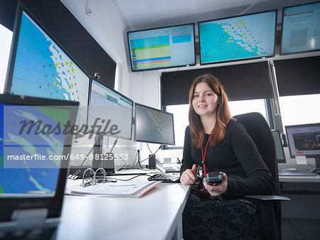 Portrait of operator in offshore windfarm control room Stock Photo - Premium Royalty-Free, Image code: 649-08125533