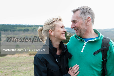 Smiling hiking couple in rural landscape Stock Photo - Premium Royalty-Free, Image code: 649-08125978