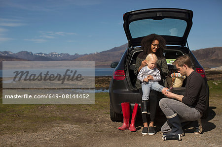 Parents helping son change shoes, Loch Eishort, Isle of Skye, Hebrides, Scotland Stock Photo - Premium Royalty-Free, Image code: 649-08144452