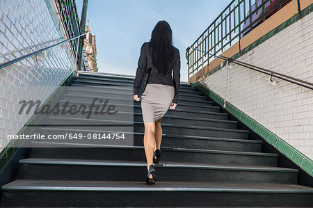 Businesswoman walking up stairs from metro station, Paris, Île-de-France, France Stock Photo - Premium Royalty-Free, Image code: 649-08144754