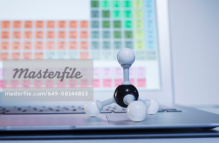 Chemistry research. A ball-and-stick methane molecule model on a laptop computer displaying periodic table elements Stock Photo - Premium Royalty-Free, Image code: 649-08144853