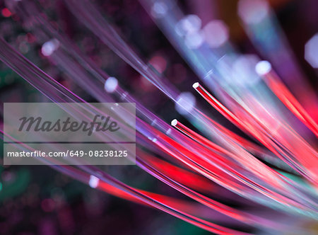 Fibre optics used to send data darting past computer circuit board Stock Photo - Premium Royalty-Free, Image code: 649-08238125
