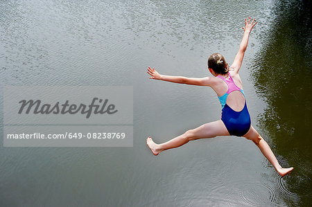 Overhead view of girl jumping into lake Stock Photo - Premium Royalty-Free, Image code: 649-08238769