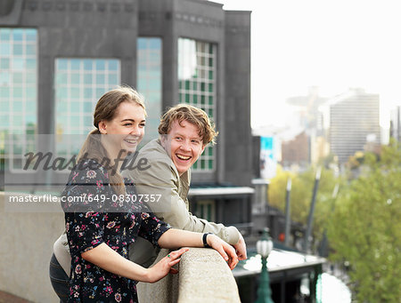 Young couple enjoying view from terrace, Melbourne, Victoria, Australia Stock Photo - Premium Royalty-Free, Image code: 649-08307357